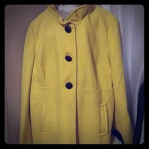 Yellow peacoat with ruffle collar.